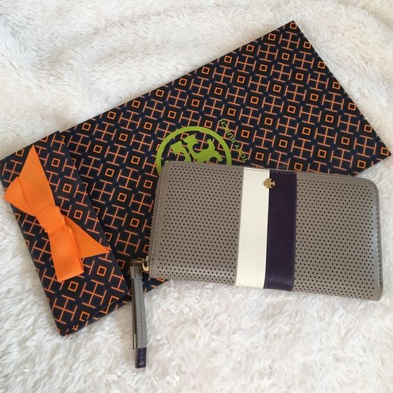 Tory Burch double stripped wallet Tory Burch Double Stripped wallet in French grey. Stripped with a white and purple and grey soft leather with holes pattern, Tory Burch gold charm accent and zipper to open/close, inside has lots of bill and card slots with zipper coin pocket. Tory Burch material lining. Super cute and functional! Gorgeous wallet! Tory Burch Bags Wallets
