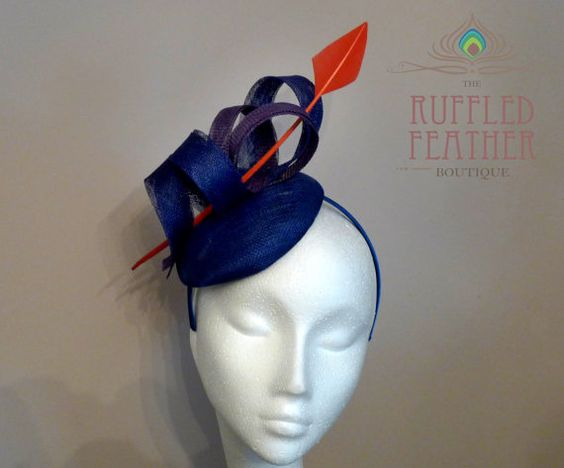 Claire Hedley Milliner - electric blue sinamay percher fascinator with blue and purple spirals and orange arrow turkey quill £49.50