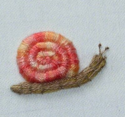 NATIONAL ESCARGOT DAY (May 24) Learn how to do Stumpwork embroidery. Click the tutorial link to go to The Floss Box. Click their tutorials and the Stumpwork snail is the 3rd from the bottom.a
