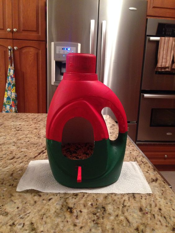 Bird Feeder Made From An Empty Laundry Detergent Bottle With A