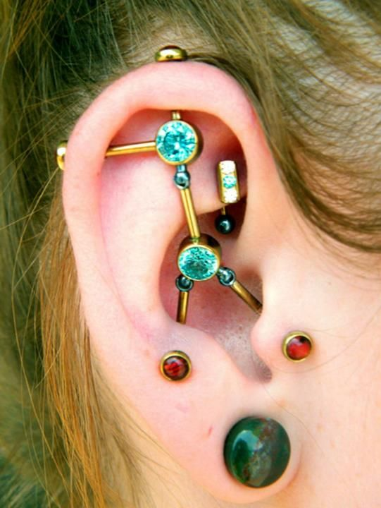 This the most epic Industrial Piercing I have ever seen ..but then you cant put in your headphones : 