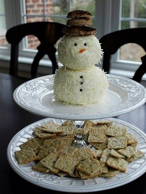 Snowman Cheeseball from Less-Than-Perfect Life of Bliss.  Cream cheese, minced garlic & shredded mozzarella.  Peppercorns for the eyes & buttons.  Shred of carrot for the nose.  Hat is cut circles from a piece of toasted wheat bread placed on the snowman's head with a toothpick.