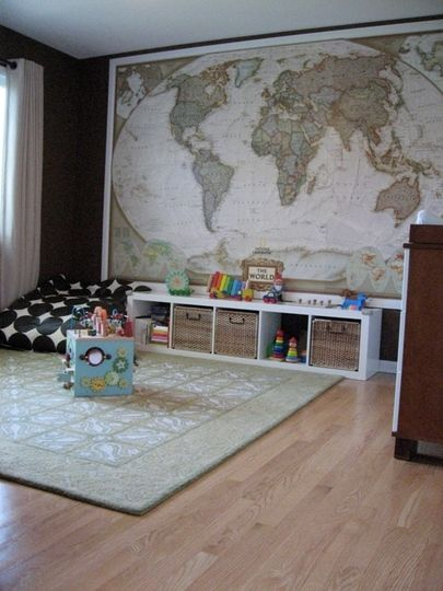 $99 map from National Geographic. Put photo's/sticker's/pin's where family has visited. F'n love.