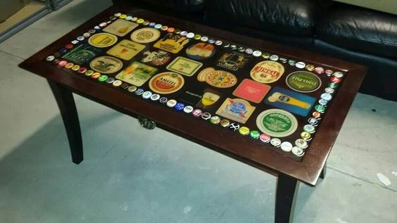 Another pic of the table i designed. Bottle cap and beer coaster table with acrylic super glaze.