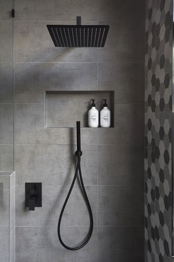 GIA renovations have created a modern grey and white bathroom with black accents, that proves you don't always need a lot of color in an interior.