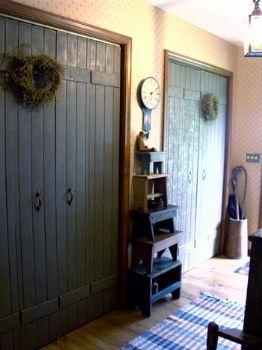 Bi-fold closet doors made to look like planked barn doors