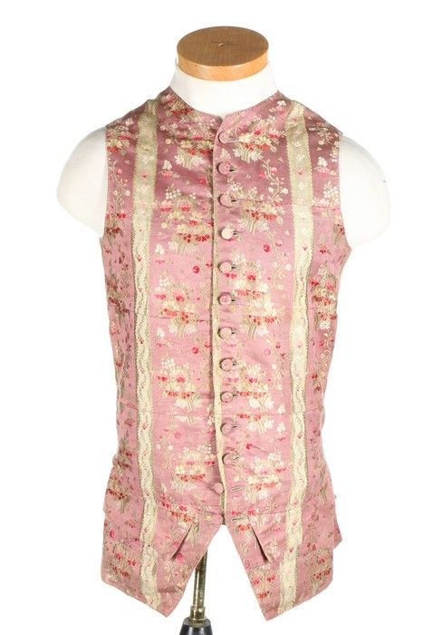 A gentleman's brocaded silk waistcoat, circa 1770. formed from joined panels of pink silk woven with stripes and flower sprays, plain linen backing, chest 92cm, 36in.