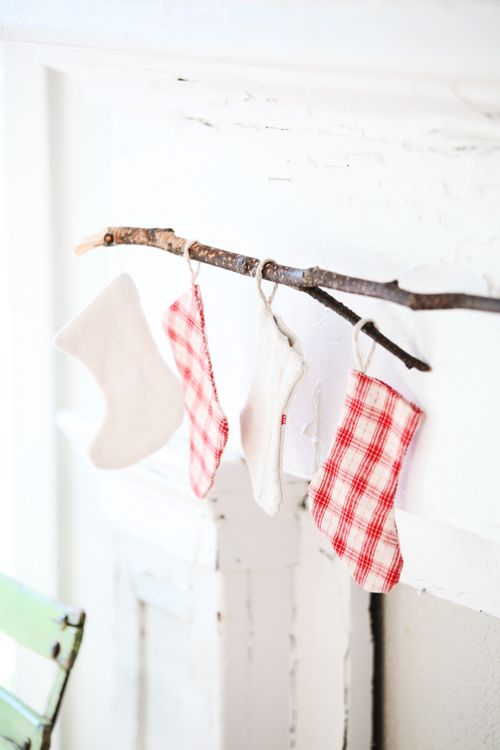 alternative choice to a fireplace mantle: hang stockings from a stick