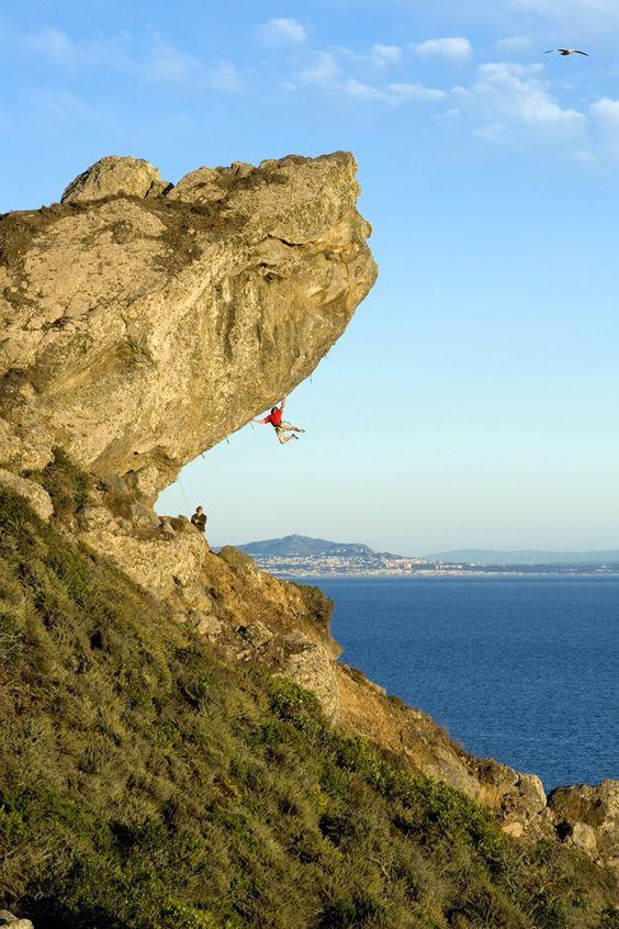 "Joe Kinder climbing ""Surf Safari"" (5.13d) Mickey's Beach, CA"