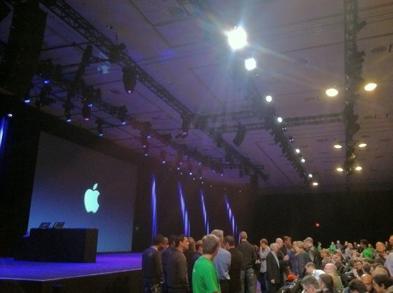 I like the way Steve Jobs presented - very Zen.  A large central screen on a colored-light, uncluttered stage.