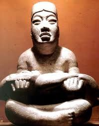 Las Limas Monument 1, considered an important realization of Olmec mythology. The youth holds a were-jaguar infant, while four iconic supernaturals are incised on the youth's shoulders and knees.  @Wikipedia
