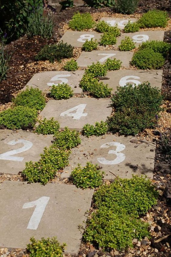 Hopscotch pavers in the garden - how cute is that! .... making a paver path from our patio to the kids playset so kids wouldnt have to walk in muddy grass.
