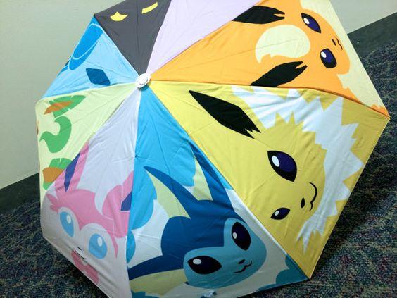 Fügen Sie einen Spritzer Farbe und Pokemon Ihre Regentagen mit diesem liebenswert Eeveelution Dach. Jede der Eeveelutions nimmt einen Keil in das Rad in