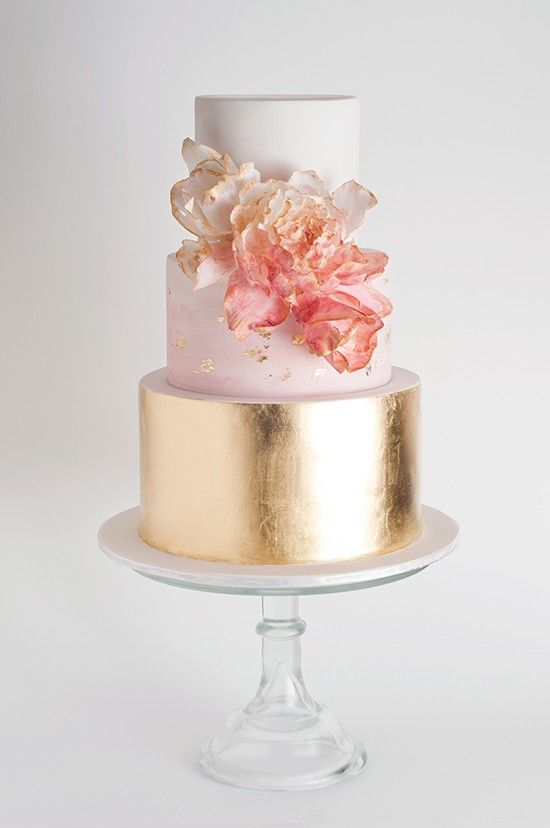 Gold tier wedding cake with ombre flowers: