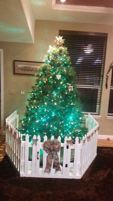 Our Christmas tree enclosure to keep our toddlers out.: