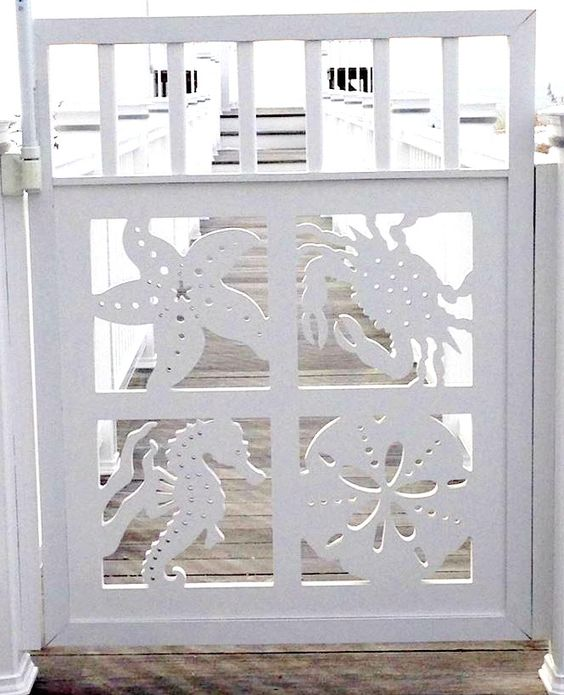 Decorative coastal gate by Island Creek Designs. A Porch Railing Panel was used to create this great gate! www.islandcreekdesigns.com