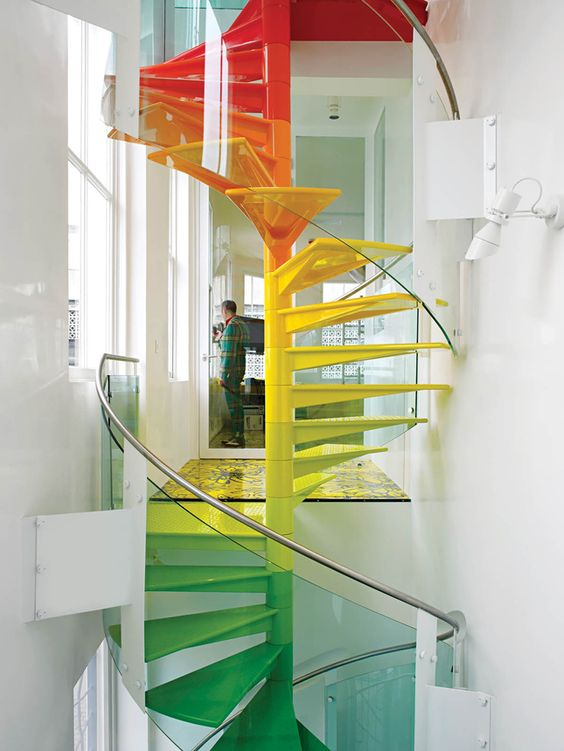 This rainbow staircase makes me smile. Just what al all white (and a bit sparse) space needs!