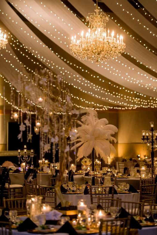 String fairy lights and have beautiful tall ostrich feather centrepieces to give your guests an unmistakeable Old Hollywood feel as soon as they enter your reception room. #oldhollywoodwedding: