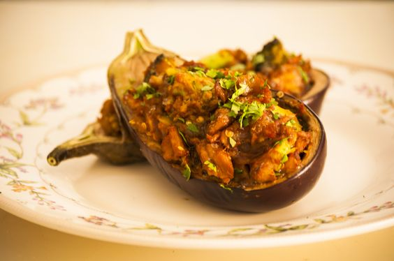 Baked Stuff Eggplant is a dish with a twist..:) the secret ingredients was not revealed....