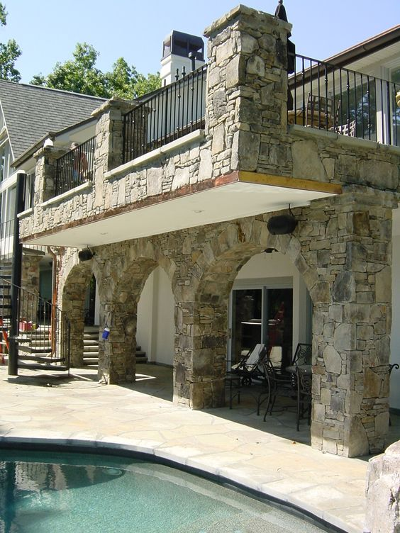 I worked on the design and installation supervision for this project while lead designer at Cascade Design Group. The cantilevered patio is a poured concrete pan with bluestone veneer. It gives the most useable space on the upper level while not crowding the pool.