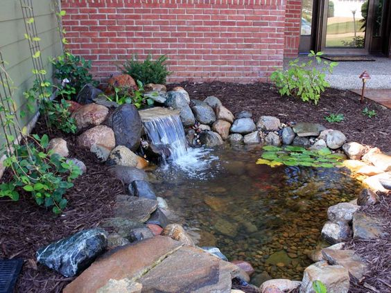 Backyard waterfall with pond minnesota waterfeatures for Fish pond features