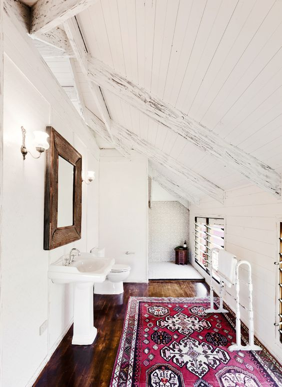 Persian rug in rustic and white bathroom: