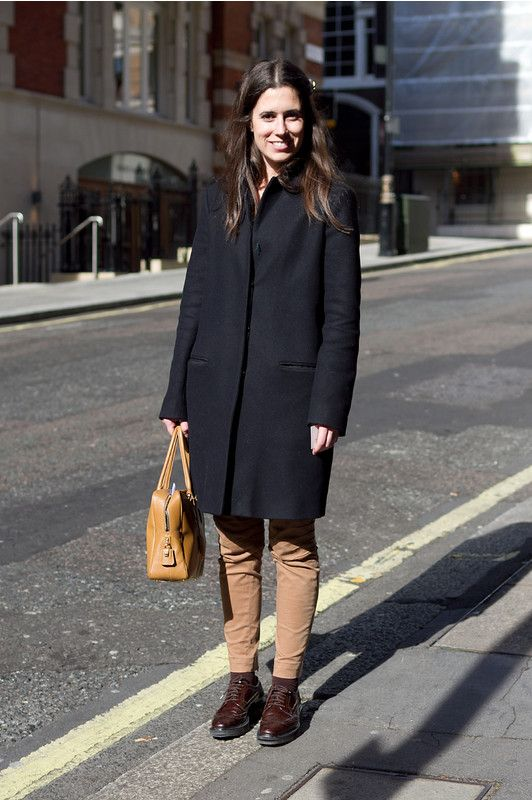 Coggles Street Style with black coat beige trousers dark brown