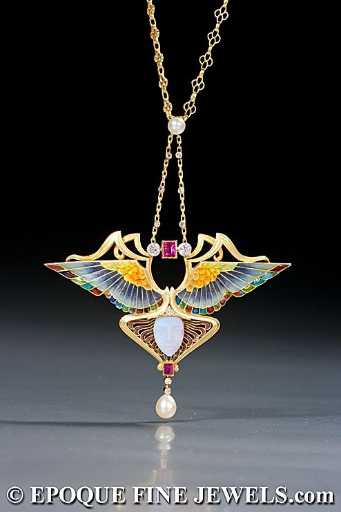PHILIPPE WOLFERS  A magnificent Art Nouveau gold, enamel, opal, ruby and diamond 'NIKE' pendant, Belgium c1902.