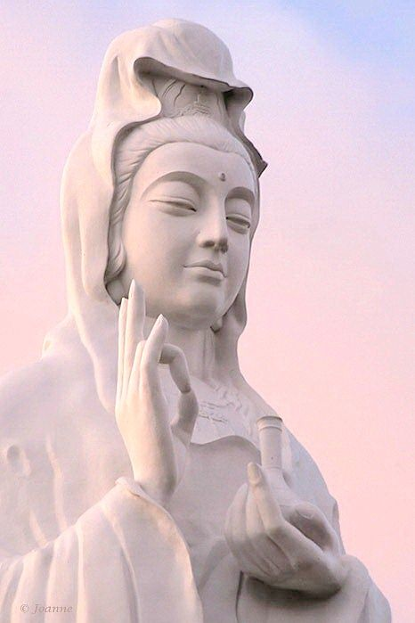 The Statue of Guanyin, China* Arielle Gabriel writes about miracles and travel in The Goddess of Mercy & The Dept of Miracles also free China toys and paper dolls at The China Adventures of Arielle Gabriel *