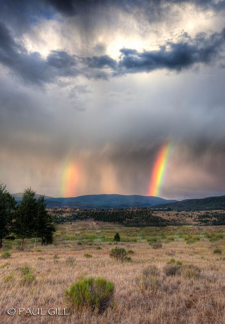 double rainbow over meadows of Angel Fire, New Mexico.