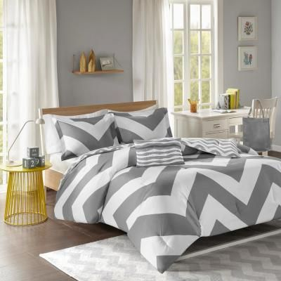 Update the look and feel of your bedroom with the Mi Zone Gemini Comforter Set. An oversized chevron pattern is displayed in vibrant grey and white hues, while a smaller scaled grey and white chevron adorns the reverse. Both the comforter and sham(s) are fully reversible, giving you the option to mix and match the different chevron prints and customize your bedroom. An oblong pillow with fabric manipulated details adds charm and dimension to bedding set. Made from ultra-soft microfiber, this com
