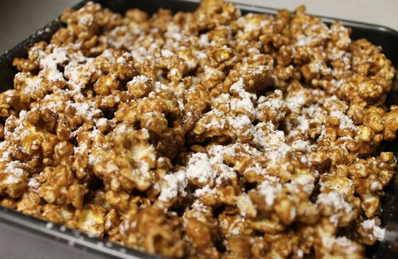 Reese's Popcorn...  pop a bag of popcorn, melt 1 cup of chocolate, 1/2 cup peanut butter, 1/4 cup butter. add a teaspoon of vanilla. mix into popcorn. place in refrigerator for 30 mins. sprinkle on some powdered sugar
