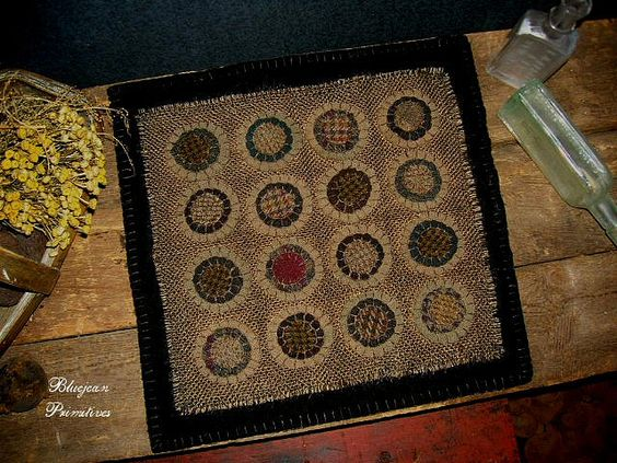 16 Pennys Early Style Penny Rug Sold by bluejeanprimitives, via Flickr