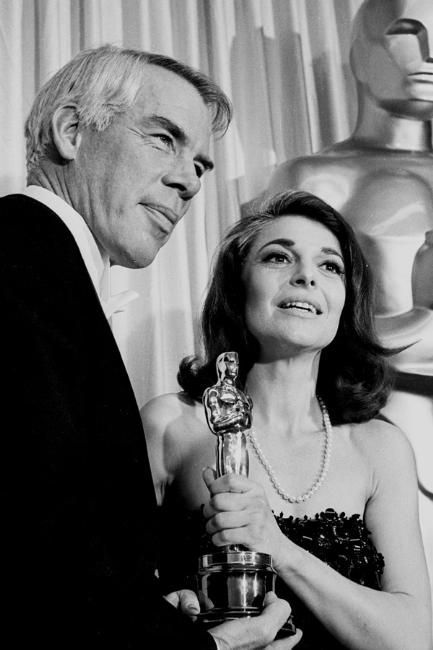 Presenter Lee Marvin and Anne Bancroft, acceptor, Actress (whos afraid of Virginia Woolf),  at the 1966 (39th) Academy Awards ceremony.