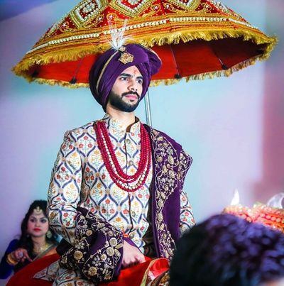 Groom Wear - Groom in a Multi Colored Sherwani with a Purple Safa | Function Mania | 7 NEW Looks for Grooms of 2018 Inspired by Pantone Colour of the Year!