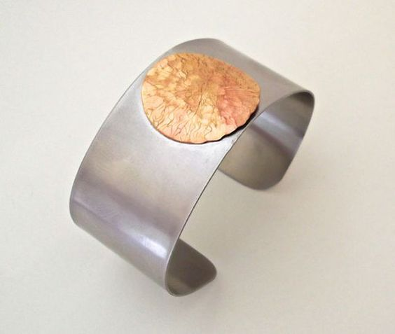 Wide stainless steel cuff with red brass