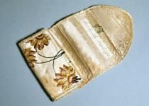 Sewing case (folded). This 19th century sewing kit was made from silk gowns that…