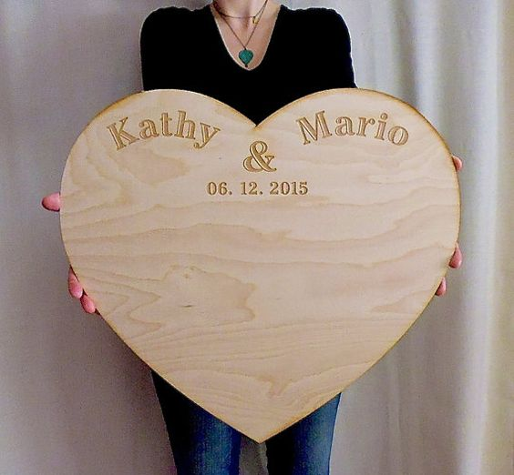 Looking for an innovative wedding guestbook? Get this large wood heart that comes personalized with your names and wedding date. Your guests will sign
