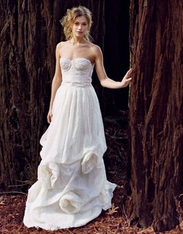 Can your wedding gown help save the planet? Sure, if it's made of organic linen. A beaded bustier with vintage lace tops a pick-up skirt crafted from a blend of eco-fabrics and showcasing oversize rosettes. About $3,000, Deborah Lindquist. Earrings, Olia Toporovsky.