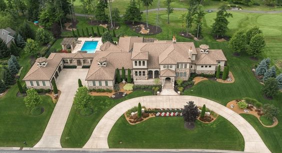 """Aurora Country Club Mansion. Worth: $5 Million.  Backstory: Built in 2011 this Country Club Mansion is shrouded in mystery as to who owns it and why they are selling. Being the most expensive home in Ohio, the owners are listed as the """"None None LLC."""" So maybe its someone really famous. The realtors will not say."""