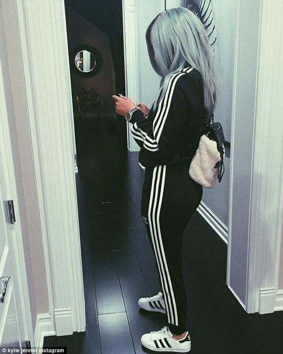 Sporty: The 17-year-old star is seen clad in an Adidas tracksuit in another snap...