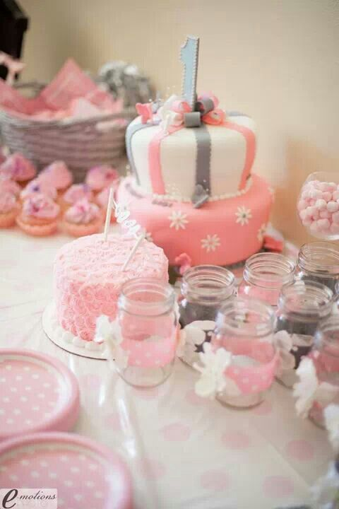 1st birthday girl table pink and gray with flowers and butterflies