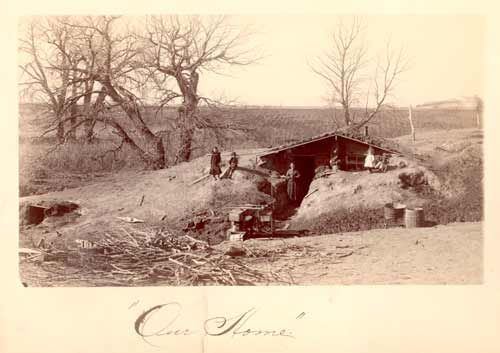 The Ingalls dugout home in Walnut Grove. Many KS pioneers made homes just like this one. Lewis Huddle & family, (the man who built our house) lived across the road from here in a dugout while building this house & farmstead buildings.
