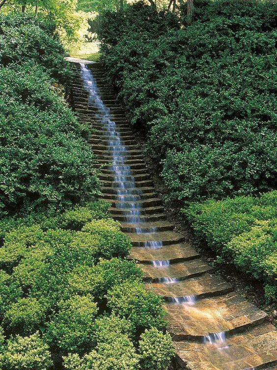 This unique water feature creates a serene backyard stream for Garden stream designs