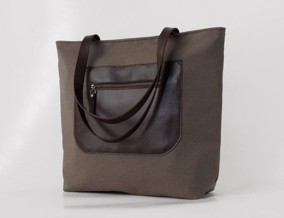 Leather front pocket, chocobrown tote / diaper bag / shoulder bag, leather handles,11 pockets.  Design by BagyBags
