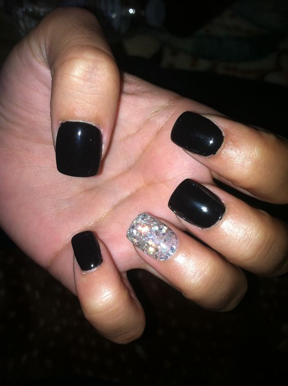 Black gel nails with one silver glitter nail. ✨
