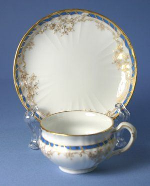 Hand Painted Mini Cup and Saucer in an unknown pattern by Königliche Porzellan-Manufaktur, Made in Germany. $79.99