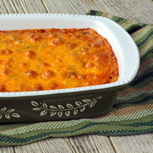Mexican Chicken Casserole is made with tortillas, chicken, chiles, a wonderful sauce, and cheese.