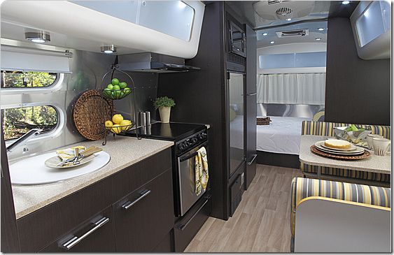 New Airstreams look like this.    Karen - like the shininess not the darkness of it, I can however envision a stamped copper or steel back splashing for kitchen round counter and stove top