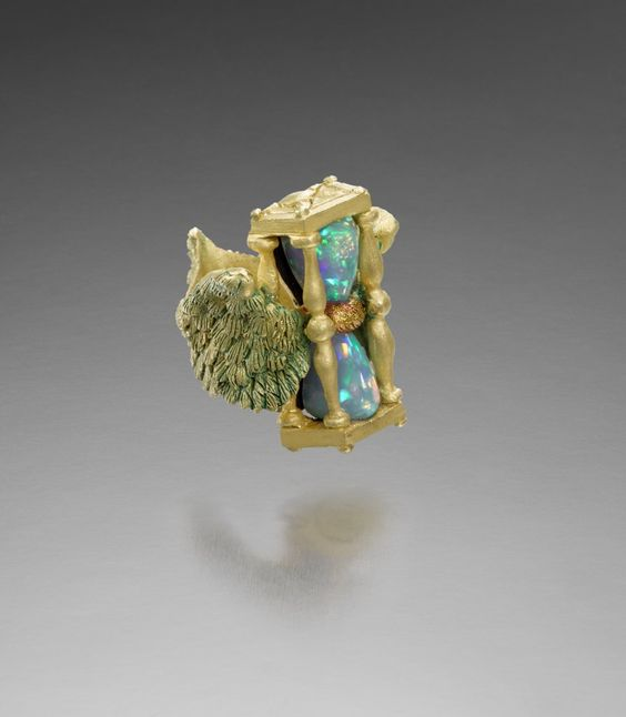"""KEVIN COATES I TEMPUS FUGIT  18K gold with patination, Ethiopian opal, silver  30mm h x 25mm x 36.5mm. Size 7 1/2.  From """"A Year of Rings,"""" 2015. Photo: Clarissa Bruce:"""
